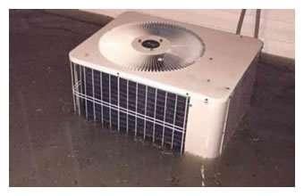 Air Conditioner Condenser Under Water - Flood Damaged Cooling Equipment