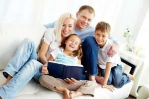 happy-family-reading-a-book - AC Replacement Naples FL - 480 x 320
