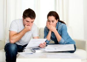 couple looking at paperwork - 5 signs your AC needs service - Fort Myers - Sunset Air and Home Services