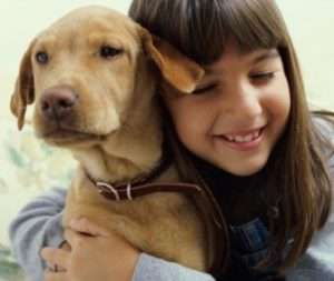 Girl hugging her dog – when to change my air filter - Fort Myers - Sunset Air Home and Home Services