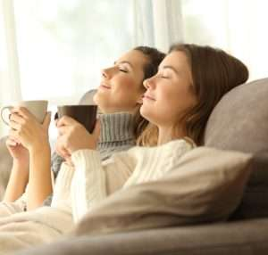 Ladies relaxing on couch– AC Maintenance Agreement - Fort Myers - Sunset Air & Home Services