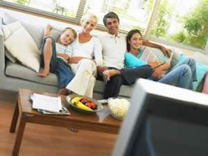 Happy Family In Living Room - Fort Myers Florida - Sunset Air and Home Services - 300 x 225