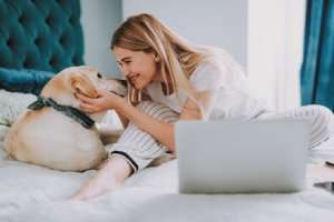 Woman and her dog celebrate having an AC Warranty - Cape Coral FL