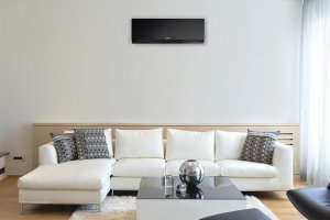 Black mini split in living room – Mini Split AC (Part 3)- Fort Myers - Sunset Air & Home Services