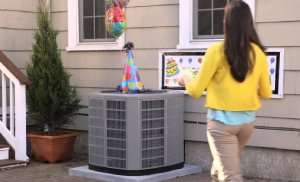 Woman celebrating her AC's 10th Birthday – AC Repair Part 2 - Sunset Air and Home Services – Fort Myers