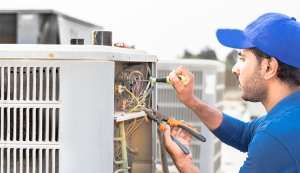 Man fixing AC condenser with tools-5 Reasons to avoid DIY AC Repairs-Sunset Air and Home Services-Fort Myers-300x173jpg
