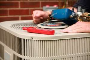 Tools on top of an AC condenser suggesting DIY repair-5 Reasons to avoid DIY AC Repairs-Sunset Air and Home Services-Fort Myers-300x200jpg