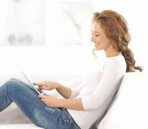 Woman On Tablet Likes Ductless AC - Sunset Air and Home Services - Fort Myers