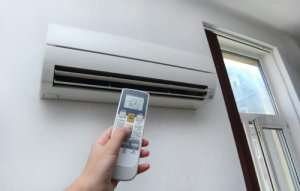 Ductless mini split on wall with remote control in garage-When to use a Ductless Mini Split-Sunset Air and Home Services-Fort Myers-300x191jpg
