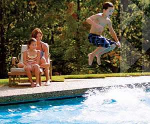 Family Having Fun In Their Heated Pool - Pentair Pool Heaters - Sunset Air and Home Services - Fort Myers Florida