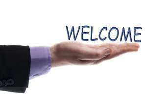 Hand with welcome sign-the power of reviews-Sunset Air and Home Services-Fort Myers-300x199jpg