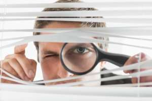 Man peeking with magnifying glass-the power of reviews-Sunset Air and Home Services-Fort Myers-300x200jpg