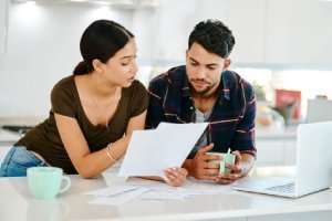 couple reading papers-AC Tips for any Season Part 3 of 3-Sunset Air and Home Services-Fort Myers-300x200jpg