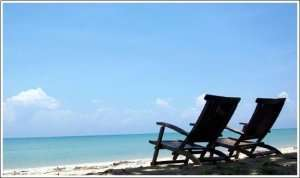 2 beach chairs on the beach-Sunset Air Home and Home Services-Fort Myers-300x178