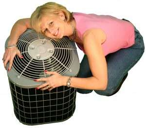 Blonde lady hugging an AC-Snowbirds-the size of your Florida HVAC matters (Part 1)-Sunset Air Home and Home Services-Fort Myers-300x263