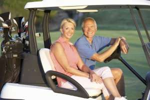 Couple on golf cart-the size of your Florida HVAC matters (Part 2)-Sunset Air Home and Home Services-Fort Myers-300x200