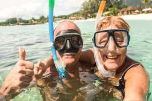 Older couple snorkeling-the size of your Florida HVAC matters (Part 1)-Sunset Air Home and Home Services-Fort Myers-300x200