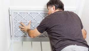 man changing air filter in home-How to Improve Indoor Air Quality (Part 1)-Sunset Air Home and Home Services-Fort Myers-300x171.jpg