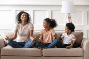 Happy family laughing on couch-Sunset Air and Home Services-Fort Myers FL-300x200pg