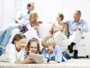 Happy multi-generational family in living room-Spring Forward with 9 Safety Checks-Sunset Air and Home Services-Fort Myers FL-300x226jpg