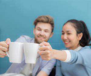 Couple toasting-Sunset Air and Home Services-7 Ways to Save Money This Summer-Fort Myers-300x200