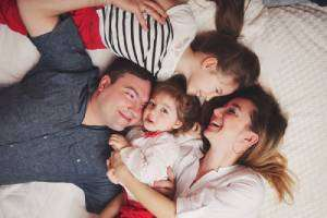 Family resting on bed-TRANE rebate up to $1200-Sunset Air and Home Services-Fort Myers, FL-300x200jpg