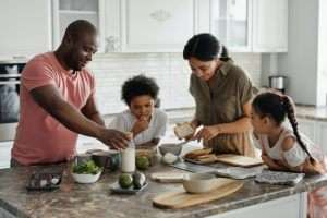 Family baking in kitchen-Is Regular AC Maintenance Needed-Sunset Air and Home Services-Fort Myers-300x200