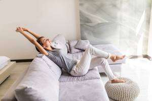 Lady relaxing on couch-Detecting Poor Indoor Air Quality-Sunset Air and Home Services-Fort Myers-300x200